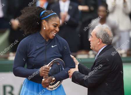 Serena Williams of the USA receives commiserations from Jean Gachassin, president of The French Tennis Federation after the Women's singles final on Day Fourteen of the 2016 French Open Tennis championship held at Roland Garros, Paris on June 4th 2016