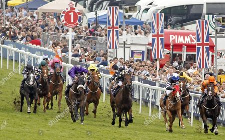 BLAINE (2nd right, Kieren Fallon) beats WASEEM FARIS (centre) and SHARED EQUITY (right) in The Investec Asset Management Stakes Epsom