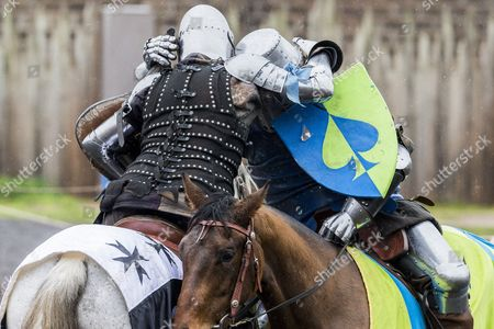 Jousters Clifford Formosa (Left) and David Williamson (right) hug after Clifford wins the jousting competition  during a professional jousting competition.