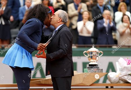Serena Williams of USA kisses Jean Gachassin receiving her runner's up trophy  during Day Fourteen of the 2016 French Open Tennis championship held at Roland Garros, Paris on June 4th 2016