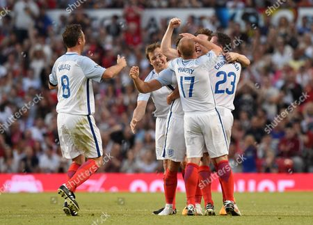 Jonathan Wilkes, Danny Murphy, Ben Shephard, Jamie Carragher and Mark Wright celebrate after Mark Wright scored