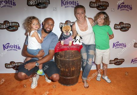 Hank Baskett, Kendra Wilkinson and Alijah Baskett with Jiffpom the Dog