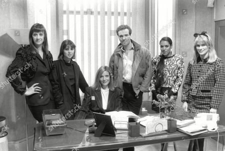 Tv Programme: Les Girls. Maggie (annie Lambert) At Her Desk Of Maggie's Models With Janet Mcteer Sadie Frost Thomas Wheatley Debby Bishop And Rachel Fielding. Box 650 304121560 A.jpg.
