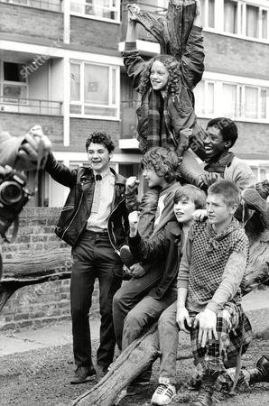 Tv Programme: The Latchkey Children. Front Row L-r: Nigel Hayward Bobby Collins Peter Harrison Marc Wood. Back Row L-r: Indra Ove Ian Roberts. Box 650 304121523 A.jpg.