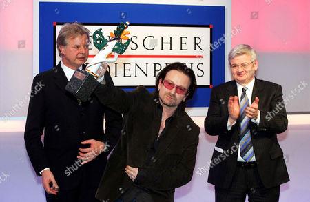 Stock Image of Karlheinz Kogel with Joschka Fischer watching Bono who was awarded the German Media Prize 2005