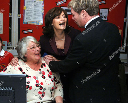 Cherie Blair visiting the adjoining Cyber Cafe where grandmother Mrs Rose Smith is learning computer skills, Headmaster, Mike Welch, encourages her thirst for knowledge.