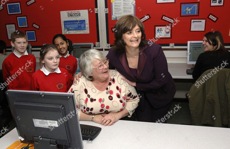 Cherie Blair visiting the adjoining Cyber Cafe where grandmother Mrs Rose Smith is learning computer skills.