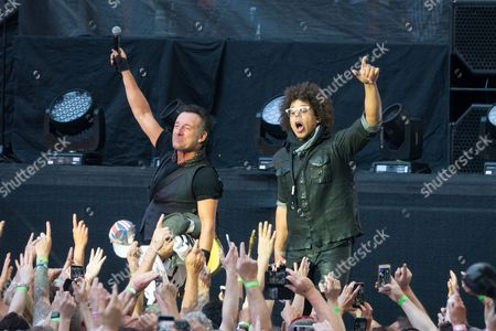 Bruce Springsteen and Jake Clemons (right) with the E Street Band