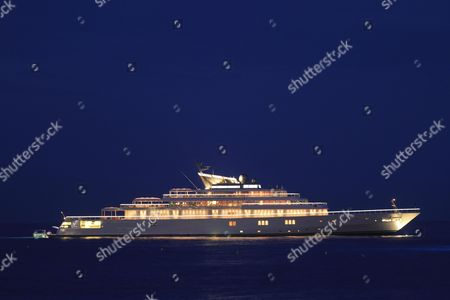 Motor yacht ''Rising Sun'', 138m, at night, built by Luersson Yachts in 2004, owned by David Geffen, previously owned by Larry Ellison, Cote d'Azur, France, Mediterranean