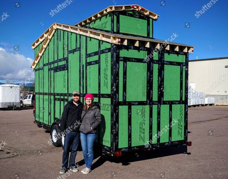 Patrick Howard and Lauren Kennedy with the tiny house while under construction