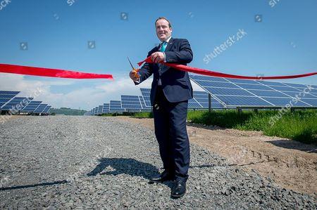 Scottish government business minister Paul Wheelhouse MSP cuts the ribbon