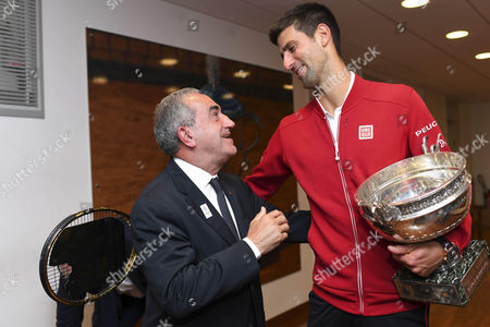 Jean Gachassin, president of the French Tennis Federation and Serbia's Novak Djokovic pose in the dressing room after defeating Britain's Andy Murray in their final match of the French Open tennis tournament at the Roland Garros stadium