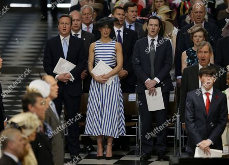David Cameron, left, his wife Samantha Cameron, second left, Chancellor of the Exchequer George Osborne, third left, and his wife Frances Osborne sing the national anthem during a National Service of Thanksgiving