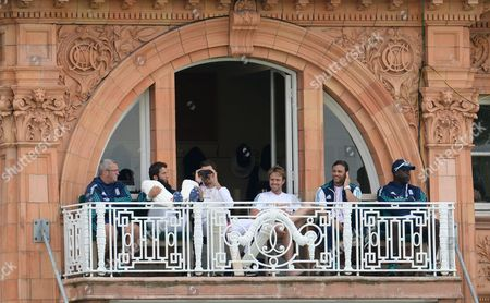 Nick Compton of England smiles on the balcony near close alongside batting coach Mark Ramprakash during day three of the 3rd Investec Test Match between England and Sri Lanka played at Lord's Cricket Ground, London on June 11th 2016