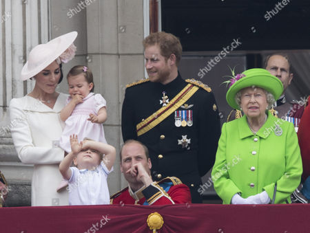 Catherine Duchess of Cambridge, Princess Charlotte of Cambridge, Prince George, Prince William, Prince Harry and Queen Elizabeth II watch the flypast from the balcony of Buckingaham Palace