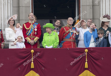 Catherine Duchess of Cambridge, Princess Charlotte of Cambridge, Prince George, Prince William, Queen Elizabeth II and Prince Philip watch the flypast from the balcony of Buckingaham Palace