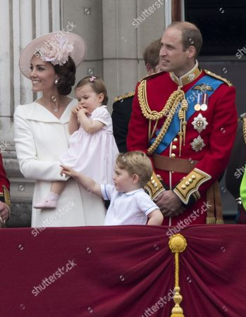 Catherine Duchess of Cambridge, Princess Charlotte of Cambridge, Prince George and Prince William watch the flypast from the balcony of Buckingaham Palace