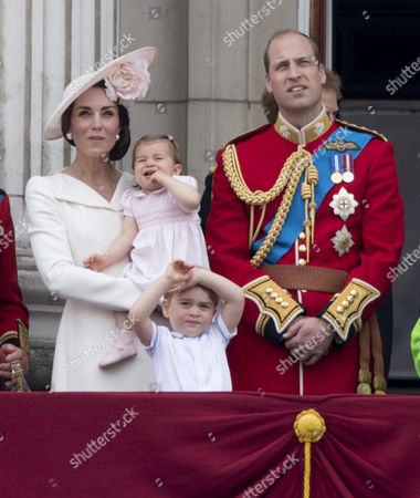 Catherine Duchess of Cambridge, Princess Charlotte of Cambridge, Prince George, Prince William watch the flypast from the balcony of Buckingaham Palace