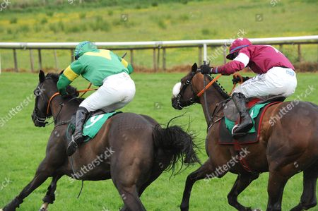 DOWNPATRICK. WESTERN GOOSE and Barry Cash (left) clears the final fence to win from AMINABAD for trainer Keith Clarke.
