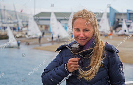 Stock Photo of Former gold Olympic medal winner Sarah Ayton commenting on the racing for Sunset and Vine TV who were covering the event