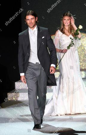 Actor Fabio Fulco walk with actress and model Vanessa Hessler on catwalk