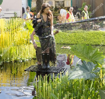 Miss Sweden Camilla Hansson Given A Helping Hand At The World Vision Garden On Show At The Rhs Chelsea Flower Show In London. 17.5.15.
