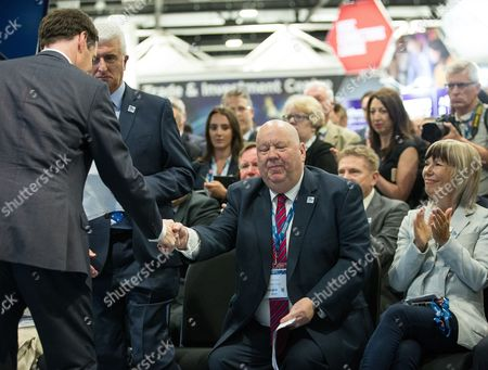 Chancellor of the Exchequer, George Osborne shakes hands with the Mayor of Liverpool Joe Anderson at the International Festival for Business at the Liverpool Exhibition Centre