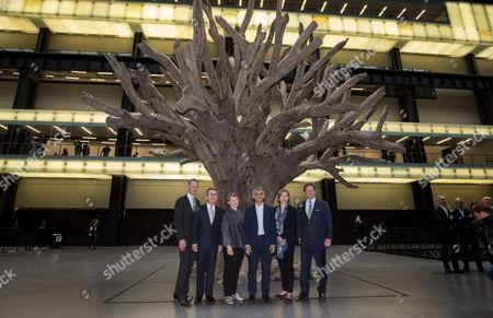 Sir Nicholas Serota, Lord John Browne, Frances Morris, Sadiq Khan, Kerstin Mogull and Ed Vaizey in the Turbine Hall with Ai Weiwei ?s 7-metre high sculpture of a tree