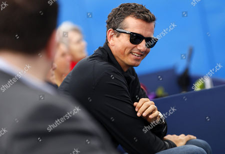 Richard Krajicek of Holland, coach of Stan Wawrinka of Switzerland, sits in the players box during Day Two of the 2016 AEGON Championships held at The Queen's Club, London on June 14th 2016