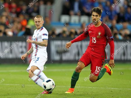 Ari Freyr Skulason of Iceland and Andre Gomes of Portugal   during the UEFA European Championships 2016 , group F match between Portugal and Iceland   played at Stadium  Geoffroy Guichard , Saint-Etienne , France on June 14th  2016