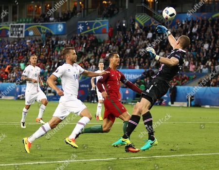Iceland goalkeeper Hannes Por Halldorsson saves from Cristiano Ronaldo of Portugal   during the UEFA European Championships 2016 , group F match between Portugal and Iceland   played at Stadium  Geoffroy Guichard , Saint-Etienne , France on June 14th  2016