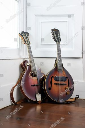 Yealmpton United Kingdom - September 17: A Vintage 1917 Gibson F4 Mandolin (L) And A 1952 Gibson Em-150 Electric Mandolin Belonging To English Musician Martin Barre Best Known As A Guitarist With Progressive Rock Group Jethro Tull Photographed At His Home In Devon On September 17