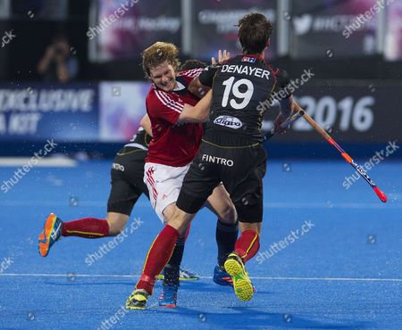 Ashley Jackson collides with Felix Denayer during the Hockey Champions Trophy 2016