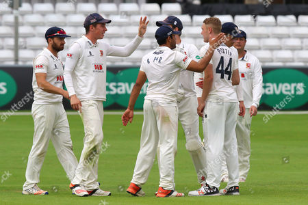Jamie Porter (2nd R) of Essex is congratulated by his team mates after taking the wicket of Clint McKay during Essex CCC vs Leicestershire CCC, Specsavers County Championship Division 2 Cricket at the Essex County Ground on 21st June 2016