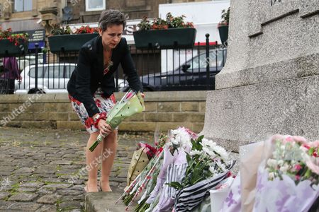 Labour MP for Wakefield Mary Creagh lays flowers in the town of Birstall, West Yorkshire, where Labour MP Jo Cox was shot and killed earlier today. Jo Cox was holding her weekly advice surgery at the time of the attack in her constituency of Batley and Spen in West Yorkshire.