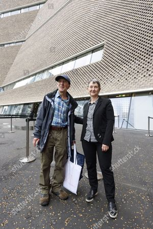 The first member of the public in the queue, Ray Cunnick aged 65 is greeted by Frances Morris, director of the Tate Modern on the first public opening day of the Tate Modern Switch House extension