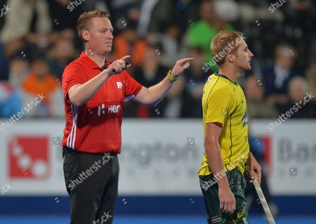 Stock Picture of Daniel Beale of Australia awaits an umpires referral from David Tomlinson over a penalty, this decision would be appealed by India after the match, thus delaying the announcement of a winner, during the FIH Mens Hockey Champions Trophy Final match between Australia and India played at the Queen Elizabeth Olympic Park, London on June 17th 2016