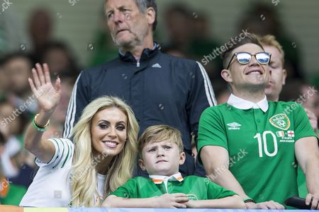 Stock Image of Claudine Palmer, wife of Robbie Keane waves tot he cameras as she stands next to their son Robert Ronan Keaneduring the UEFA European Championships 2016, Group E match between Belgium and Republic of Ireland played at Stade de Bordeaux, Bordeaux, France on June 18th 2016