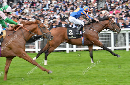 Stock Image of Churchill (Ryan Moore) wins The Chesham Stakes from (L) Isomer (Jamie Spencer) on Day 5 of The Royal Ascot meeting @ Ascot Racecourse, Berkshire, Great Britain on 18th June 2016.