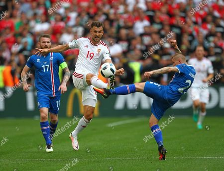 Tamas Priskin of Hungary battles with Ari Freyr Skulason of Iceland   during the UEFA European Championships 2016 , group F match between Iceland and  Hungary    played at Stadium Velodrome  , Marseille , France on June 18th  2016