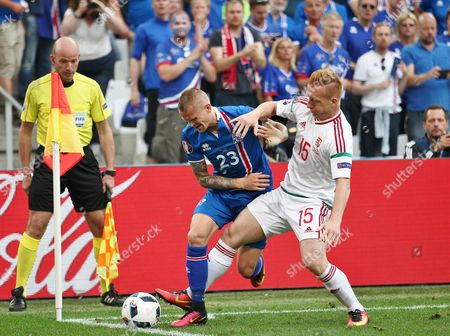 Ari Freyr Skulason of Iceland battles with Laszlo Kleinheisler of Hungary   during the UEFA European Championships 2016 , group F match between Iceland and  Hungary    played at Stadium Velodrome  , Marseille , France on June 18th  2016