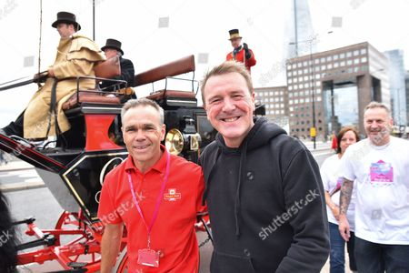 Stock Image of Mark Penfold (L) and Phil Tufnell. Mark Penfold has walked 500 miles from Edinburgh to London to raise money for the Lily Foundation and those suffering from Mitochondrial disease as a horse-drawn mail coach travels across London Bridge to Guildhall as part of the 500 years celebration.