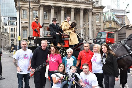 Mark Penfold (in red) and Phil Tufnell. Mark Penfold has walked 500 miles from Edinburgh to London to raise money for the Lily Foundation and those suffering from Mitochondrial disease as a horse-drawn mail coach travels across London Bridge to Guildhall as part of the 500 years celebration.