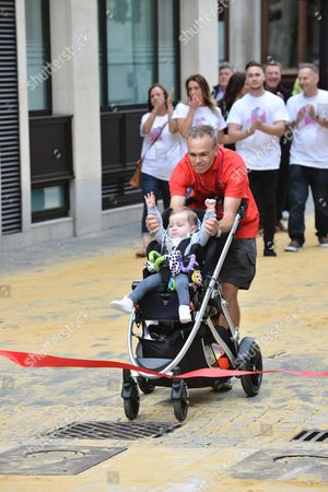 Mark Penfold has walked 500 miles from Edinburgh to London to raise money for the Lily Foundation and those suffering from Mitochondrial disease. A horse-drawn mail coach travels across London Bridge to Guildhall as part of the 500 years celebration.