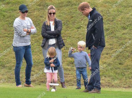 Prince Harry, Zara Tindall, Mia Grace Tindall and son of polo player Malcolm Borwick