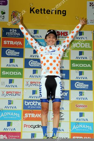 Strava Queen of the Mountains winner Katie Hall on the podium of final stage of the Aviva Women's Tour.