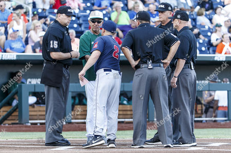 Miami head coach Jim Morris and Arizona head coach Jay Johnson exchange lineup cards and shake hands before the start of game 2 of the NCAA Men's College World Series between Arizona Wildcats and Miami Hurricanes at TD Ameritrade Park in Omaha