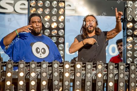 Stock Photo of Free concert featuring Bob Sinclar with Big Ali in the Lyon fan zone on Bellecour square in Lyon, before the match Switzerland vs France, a match of the UEFA EURO 2016 soccer championship central eastern France, on June 19, 2016