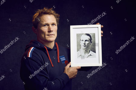 Josh Lewsey MBE, World Cup-winning England rugby player and former Royal Artillery officer holding a picture of Lt Col Edgar Roberts Mobbs DSO