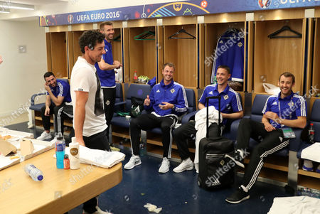 Rory McIlroy pictured in the team changing room with Conor McLaughlin, Gareth McAuley, Jonny Evans, Chris Baird and Niall McGinn after Tuesday evenings final Euro 2016 group game